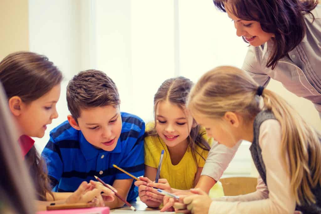 photo of children with teacher