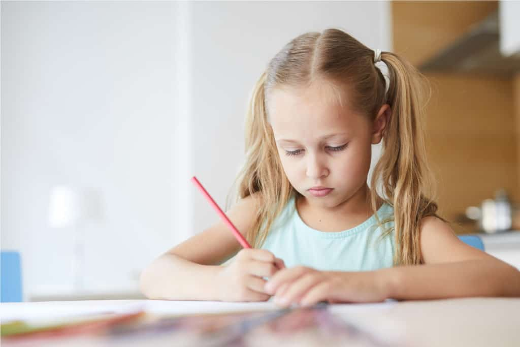photo of a girl writing